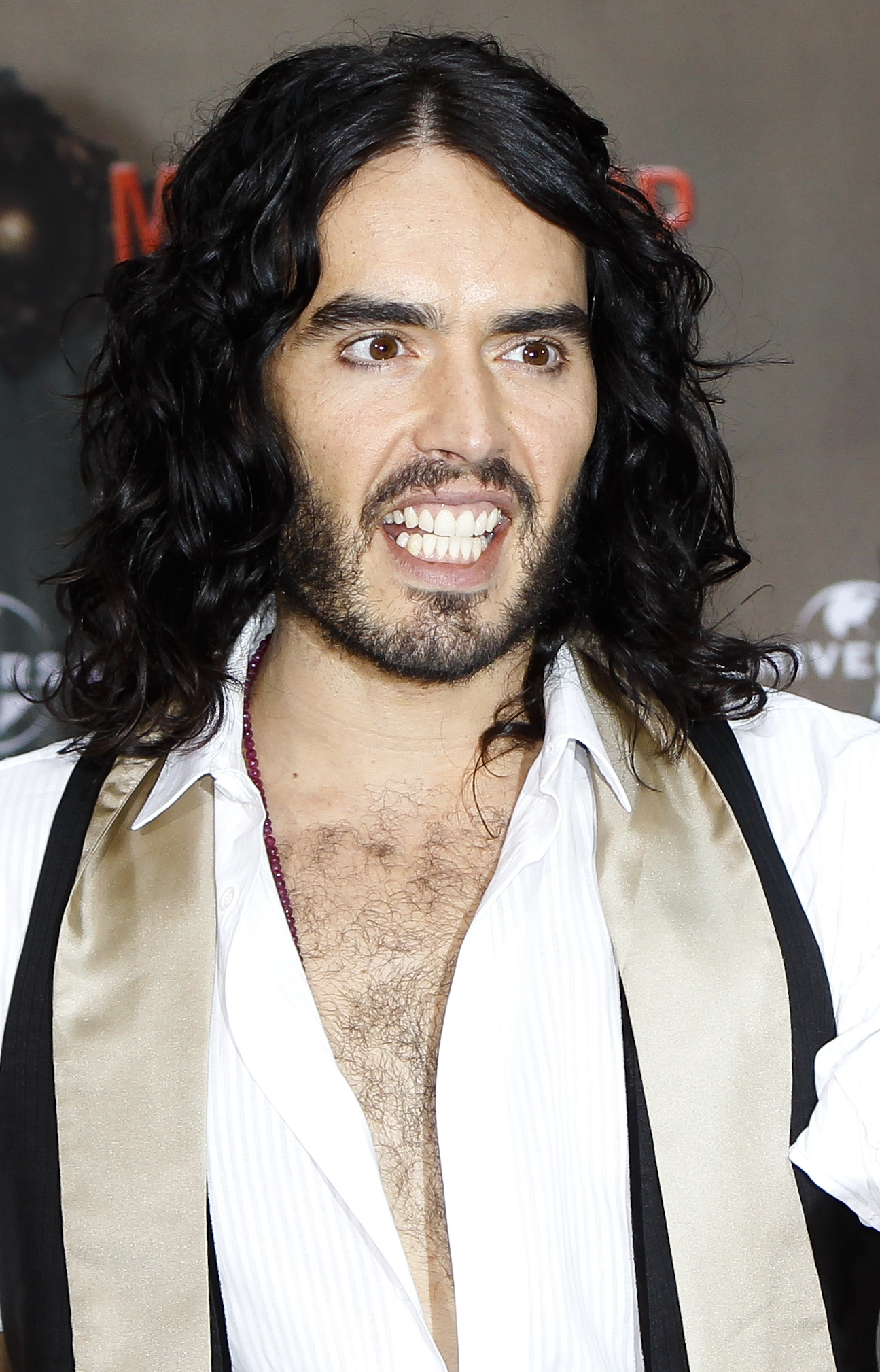 """Thanks for your sweet messages of support. After the tips I picked up in chokey I'm an infinitely more proficient criminal,"" Russell Brand tweeted after he was arrested following an altercation with a paparazzo at Los Angeles International Airport. Brand claims the photographer was trying to take a picture up his fiancée Katy Perry's skirt. He was charged with misdemeanor battery and is out on $20,000 bail with an Oct. 15 court date. (AP Photo/Markus Schreiber)"