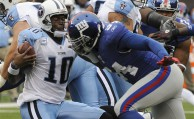 New York Giants defensive end Mathias Kiwanuka, right, sacks Tennessee Titans' Vince Young (10) during the first quarter of an NFL football game at New Meadowlands Stadium, Sunday, Sept. 26, 2010, in East Rutherford, N.J.  (AP Photo/Bill Kostroun)