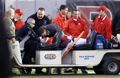 Rutgers head coach Greg Schiano leans over defensive tackle Eric LeGrand (52) as personnel prepare to take him from the field after colliding with Army's Malcolm Brown (23) as he tried to make the tackle during the second half of a football game Saturday, Oct. 16, 2010, in East Rutherford, N.J. Rutgers won 23-20 in overtime. (AP Photo/Mel Evans)