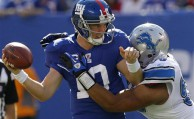 New York Giants quarterback Eli Manning (10) is sacked by Detroit Lions defensive tackle Ndamukong Suh, right, during the second quarter of an NFL football game at New Meadowlands Stadium, Sunday, Oct. 17, 2010, in East Rutherford, N.J.  (AP Photo/Seth Wenig)