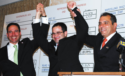 From left: Jack Martins, Edward Ra and Joseph Saladino, all Republicans, celebrate their victories after midnight Wednesday.
