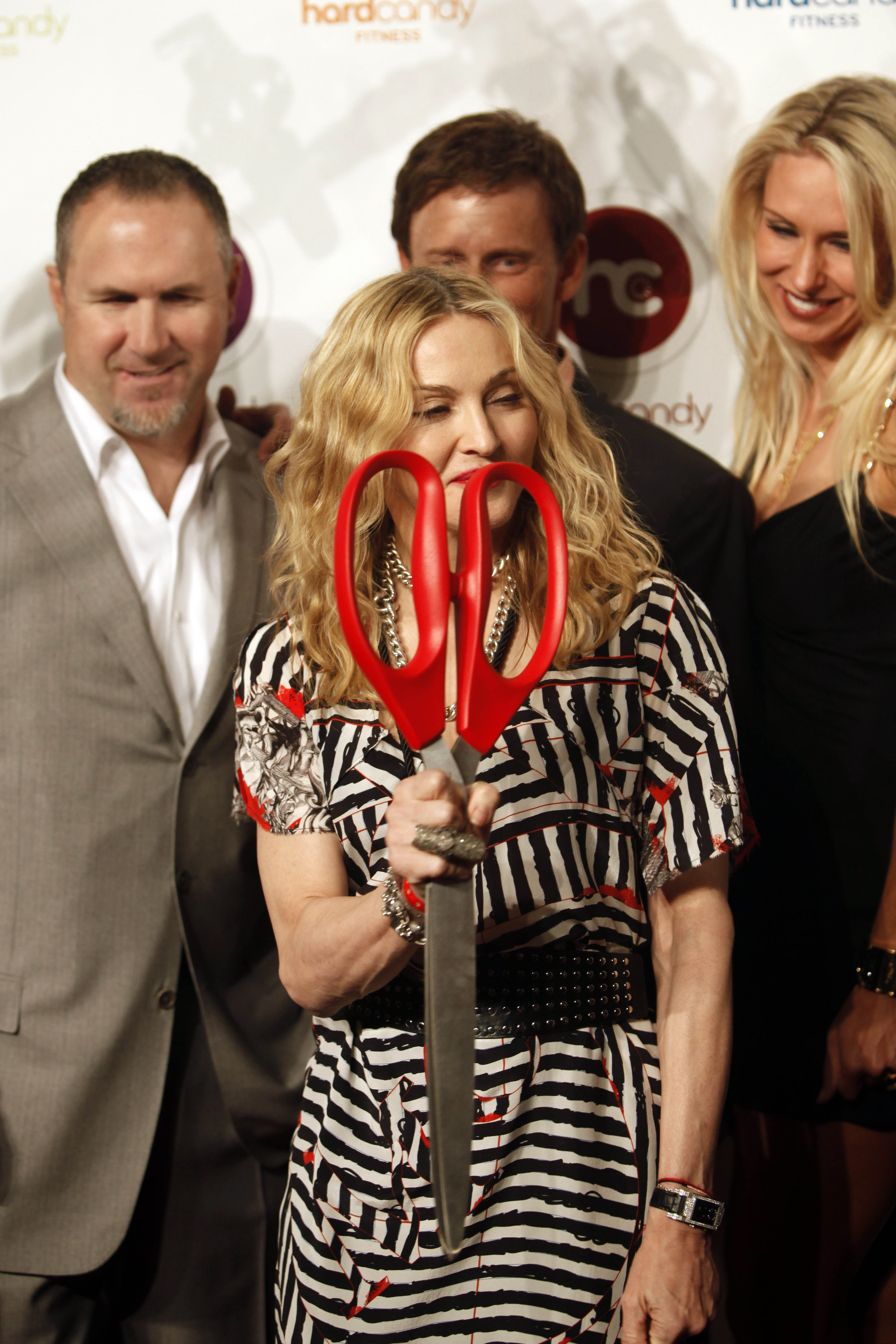 """It's a sexy name that gives you the opportunity to have fun and to build strength as far as the imagination will allow,"" —Madonna on her new gym Hard Candy Fitness, which opened Nov. 29 in Mexico City. The singer plans on expanding the brand into the United States and globally once it is fine-tuned. (AP PHOTO/MIGUEL TOVAR)"