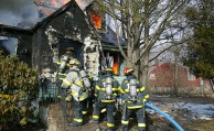 Gordon Heights Fire Department firefights battle a blaze in 2009. Brookhaven township officials are reviewing a study that details how to best mitigate the fact that Gordon Heights residents pay the highest fire district taxes on Long Island (courtesy of Gordon Heights Fire Department)