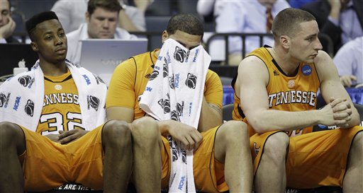 Tennessee players, from left,  Scotty Hopson, Brian Williams and Steven Pearl sit on the bench in the closing minutes of the second half of a West Regional NCAA tournament second round college basketball game against Michigan, Friday, March 18, 2011, in Charlotte, N.C. Michigan won 75-45. (AP Photo)