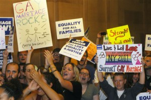 Supporters of same sex marriage celebrate that the Senate members will vote on legislation to legalize same-sex marriage in New York, during a session of the New York State Senate at the Capitol in Albany, N.Y., Friday, June 24, 2011. (AP Photo/Hans Pennink)
