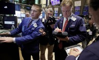 Specialist Frank Masiello, left, works with traders on the floor of the New York Stock Exchange Friday, Aug. 12, 2011. (AP Photo/Richard Drew)