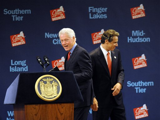 Former President Bill Clinton walks to the podium after New York Gov. Andrew Cuomo introduces him during a New York Open for Business Statewide Conference at the Empire State Plaza Convention Center in Albany, N.Y., Tuesday, Sept. 27, 2011. A $4.4 billion high-tech project involving five global companies will create or retain 6,900 jobs statewide, Cuomo announced Tuesday. (AP Photo/Hans Pennink)