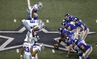 The Dallas Cowboys and New York Giants line up at midfield during the first half of an NFL football game Sunday, Dec. 11, 2011, in Arlington, Texas. (AP Photo/Sharon Ellman)