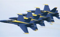 FILE - In this Nov. 2, 2006 file photo, members of the U.S. Navy Blue Angels precision flying team rehearse at Little Rock Air Force base in Jacksonville, Ark. The Navy's Blue Angels have been thrilling audiences for more than six decades with their acrobatic flying. The Navy's Blue Angels have been thrilling audiences for more than six decades with their acrobatic flying in fighter planes, but a new era of federal budget worries and proposed deficit cutting has some inside and outside the military, raising questions about the millions it costs to produce their shows. (AP Photo/Danny Johnston, File)