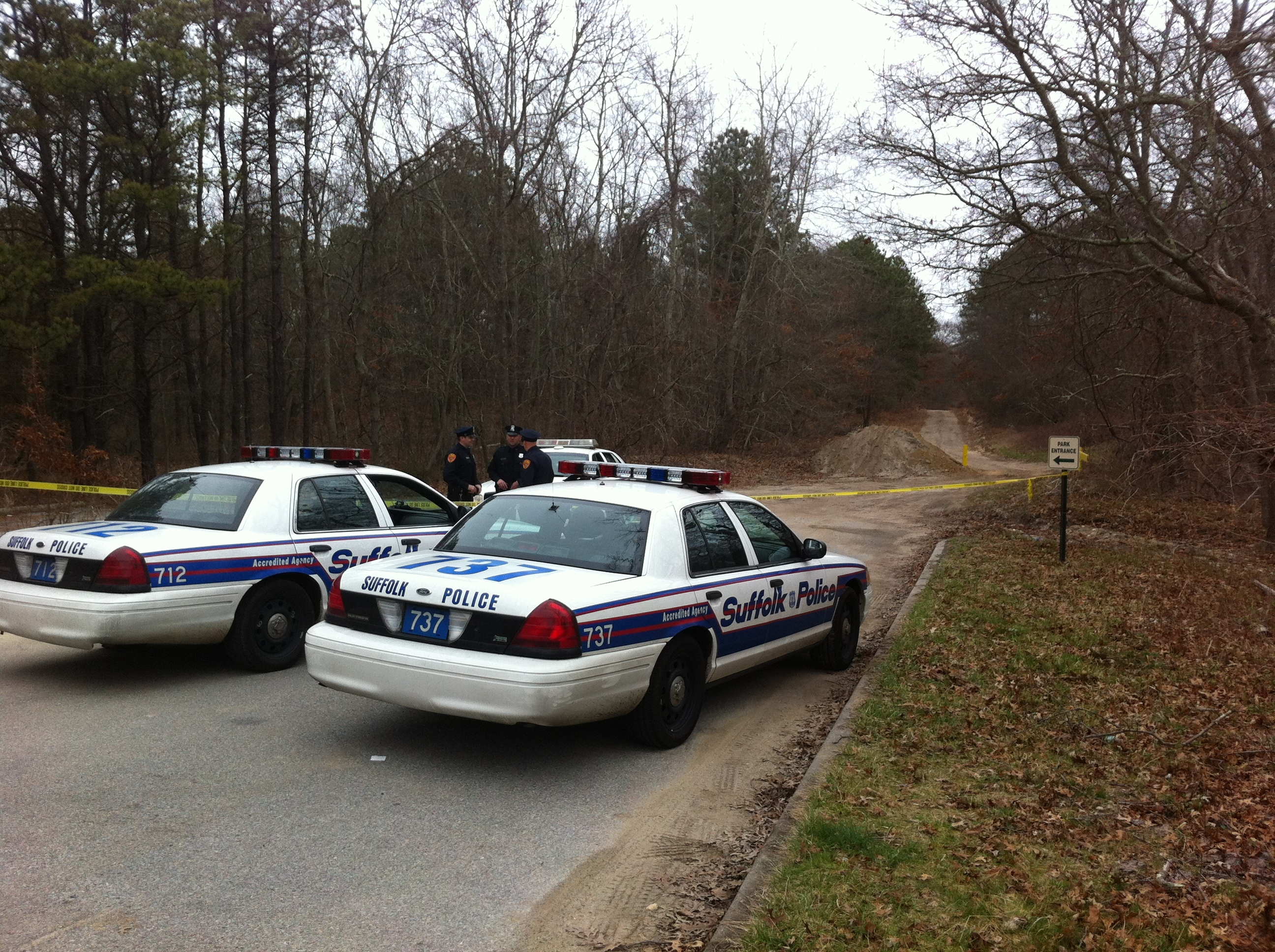 Two police cars blocking the area of Manorville where a body was found Wednesday, March 21, 2012