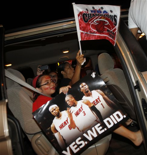 Miami Heat fans in Hialeah, Fla., Friday June, 22, 2012 celebrate the Heat's win over Oklahoma City Thunder after Game 5 of the NBA finals basketball series. The Heat won 121-106 to become the 2012 NBA Champions. (AP Photo/Alan Diaz)
