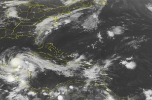 This NOAA satellite image taken Wednesday, Aug. 08, 2012 at 1:45 a.m. EDT shows Hurricane Erneseto passing through the Yucatan Peninsula. Outer bands of the Ernesto extend eastward across the northwestern and central Caribbean Sea. (AP PHOTO/WEATHER UNDERGROUND)