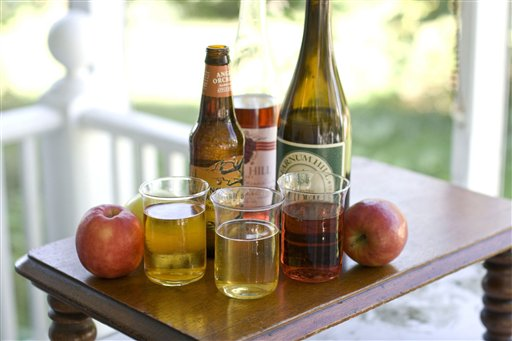 In this image taken on August 27, 2012, from left, glasses of hard apple cider, apple beer, and apple wine, along with, from left, bottles of beer, wine, and hard cider are shown in Concord, N.H. (AP Photo/Matthew Mead)