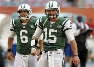 In this Sept. 23, 2012, file photo, New York Jets quarterbacks Tim Tebow (15) and Mark Sanchez (6) warm up before an NFL football game against the Miami Dolphins in Miami . (AP Photo/Wilfredo Lee, File)