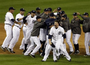 Detroit Tigers' Phil Coke and teammates celebrate after winning Game 4 of the American League championship series against the New York Yankees Thursday, Oct. 18, 2012, in Detroit. The move on to the World Series. (AP Photo/Darron Cummings)
