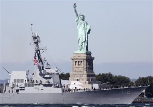 The U.S. Navy's newest destroyer, the USS Michael Murphy, powers past the Statue of Liberty as it heads into New York Harbor, Monday, Oct. 1, 2012, in New York. The Arleigh-Burke class destroyer is named for Medal of Honor recipient Michael Murphy, who was killed in Afghanistan in June 2005. (AP Photo/Mark Lennihan)