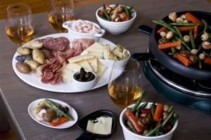 In this image taken on December 3, 2012, New Year's Eve raclette is shown served on a table in Concord, N.H. (AP Photo/Matthew Mead)