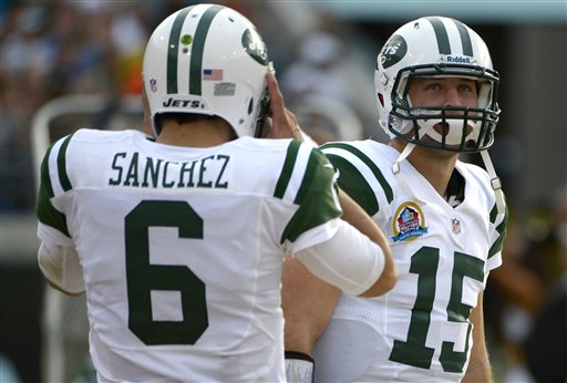 New York Jets quarterback Mark Sanchez (6) talks with quarterback Tim Tebow (15) on the sideline during the second half of an NFL football game against the Jacksonville Jaguars in Jacksonville, Fla., Sunday, Dec. 9, 2012. (AP Photo/Phelan M. Ebenhack)
