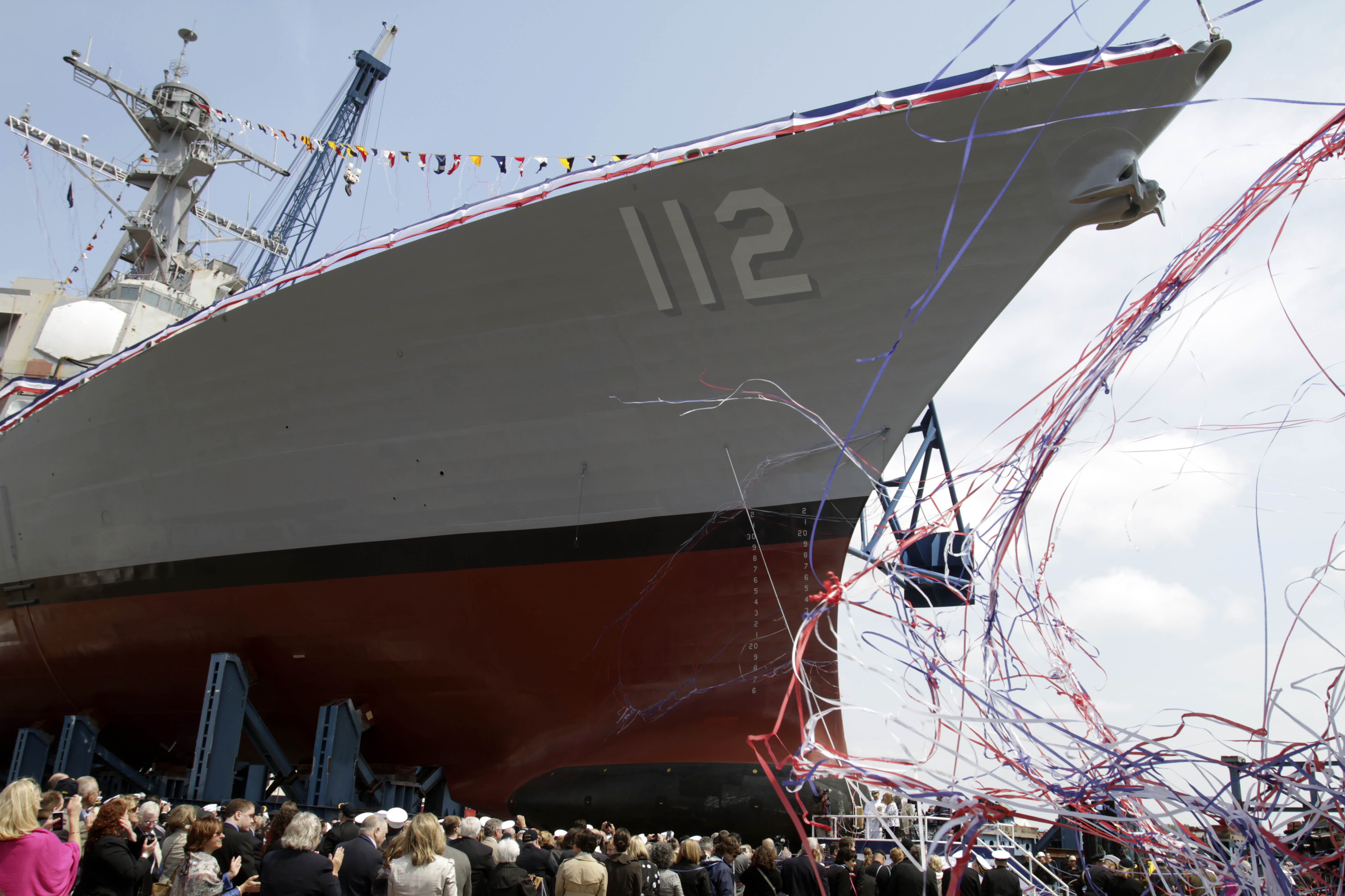 """Maureen Murphy, mother of  Medal of Honor recipient and U.S. Navy SEAL, Lt.  Michael Murphy, christens the ship baring his name during a ceremony at the Bath Iron Works shipyard in Bath, Maine on Saturday, May 7, 2011, what would've been Murphy's 35th birthday. The mother of a Navy SEAL from Maine killed in Afghanistan said """"Happy birthday, baby"""" before smashing a bottle of Champagne against a Navy ship that bears her son's name. (AP Photo/Pat Wellenbach)"""